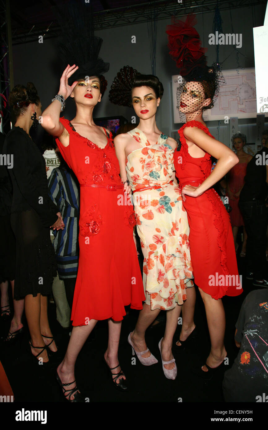 John Galliano Backstage Paris Spring Summer Model wearing red dress red and  black sequins 7d11e215bef