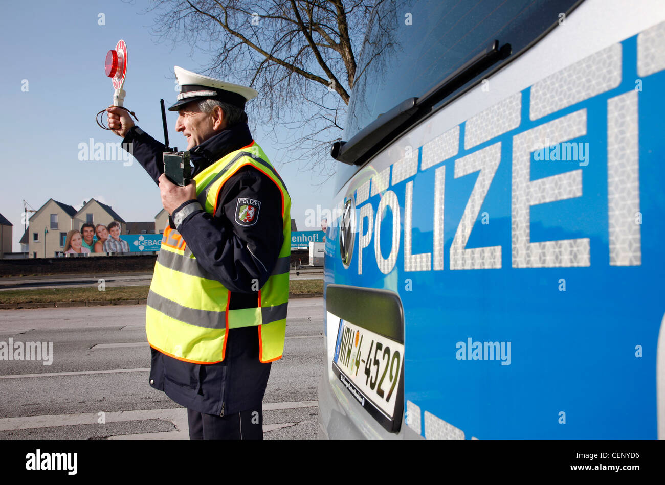 Police control, traffic speed control, police officer stops cars on a street. - Stock Image