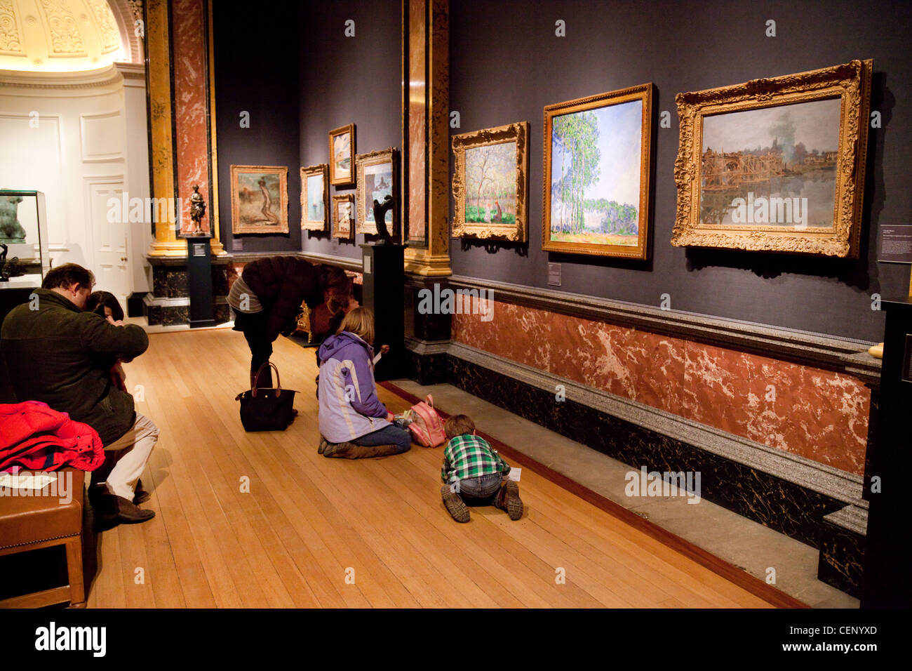 Families  in one of the art galleries of the Fitzwilliam Museum, cambridge UK - Stock Image
