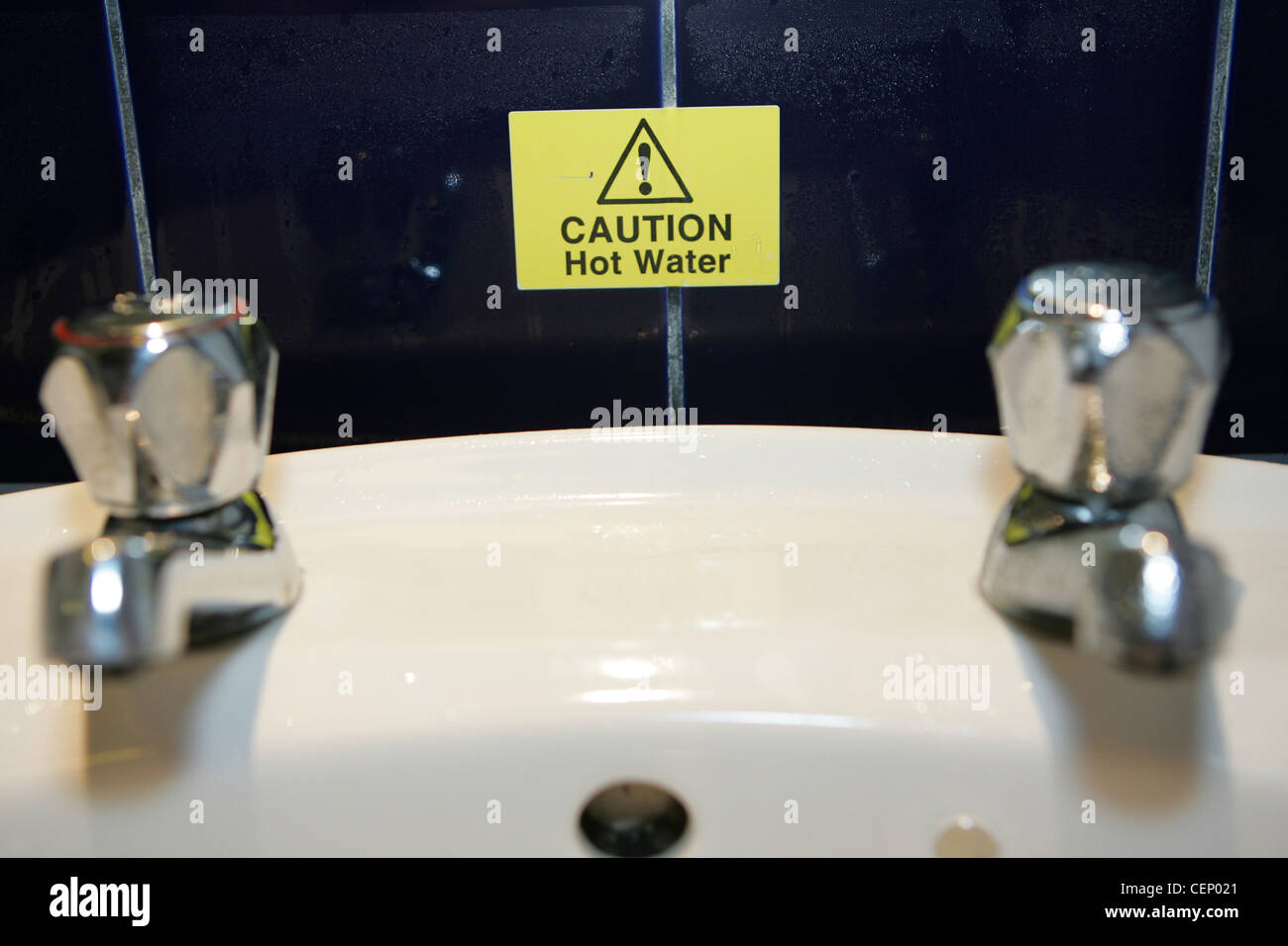 caution hot water sign in uk hotel room - Stock Image