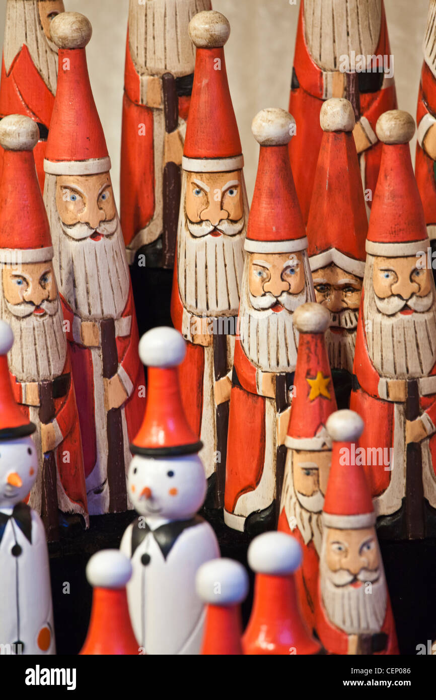 wooden santa claus christmas decorative ornaments on sale at a german christmas market in leeds