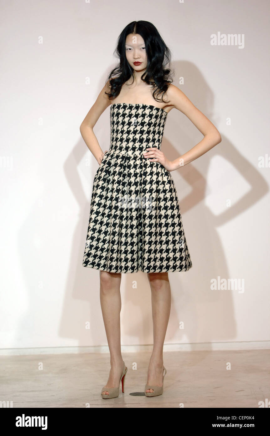 a02648f171 Martin Grant Ready to Wear Paris A W Asian female model wearing a strapless  houndstooth tweed black and white dress full skirt