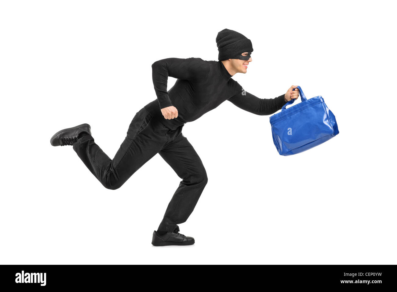 Full length portrait of a thief running with a stolen purse isolated on white background - Stock Image