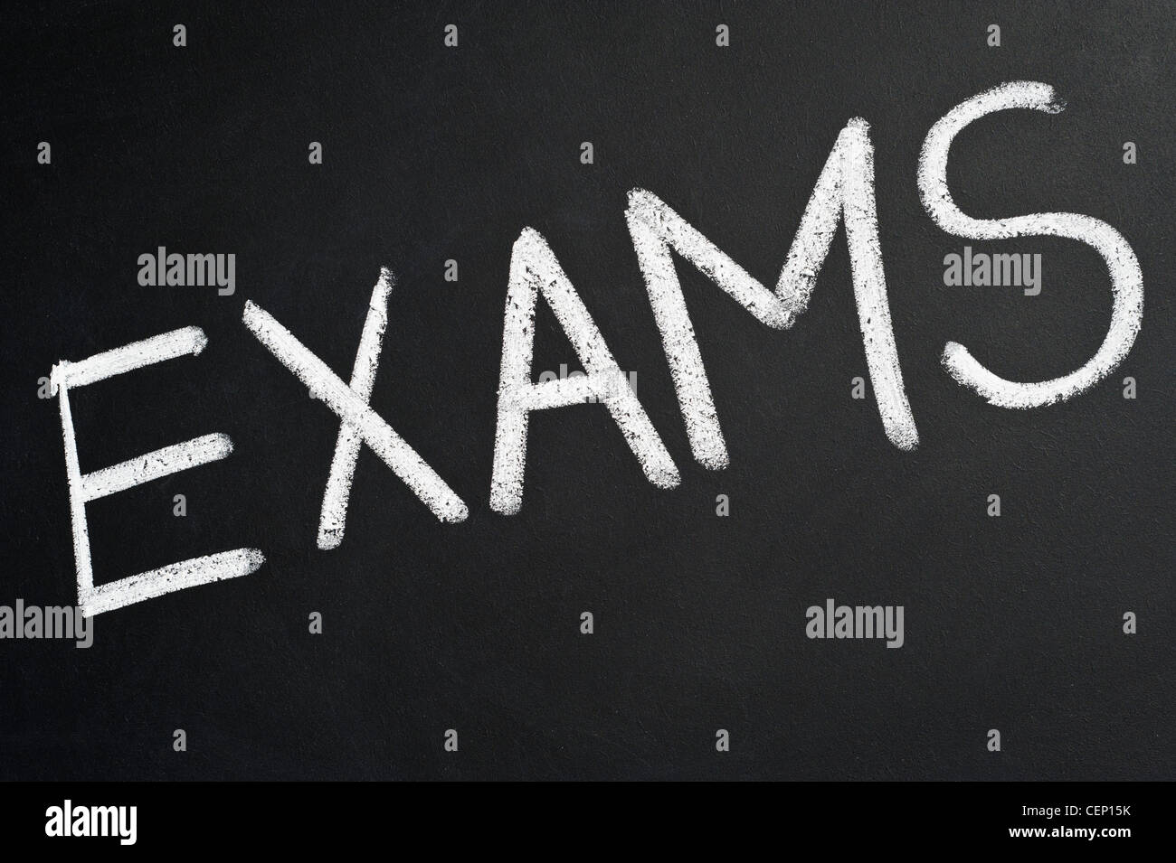 Blackboard with the word EXAMS written on it in white chalk - Stock Image