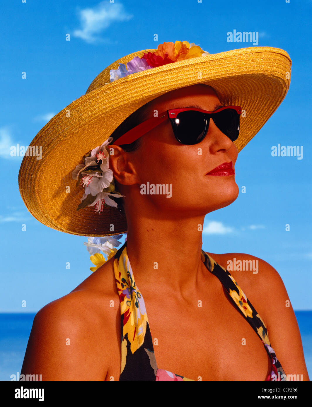 WD1453-41 Female wearing sunglasses and sun hat with a suntan - Stock Image