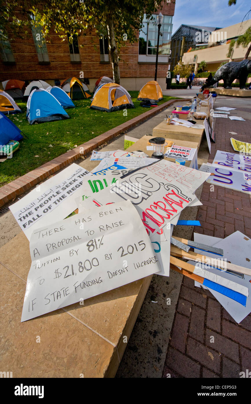 Signs protesting tuition increases at the University of California at Los Angeles (UCLA) lie on a campus bench. - Stock Image