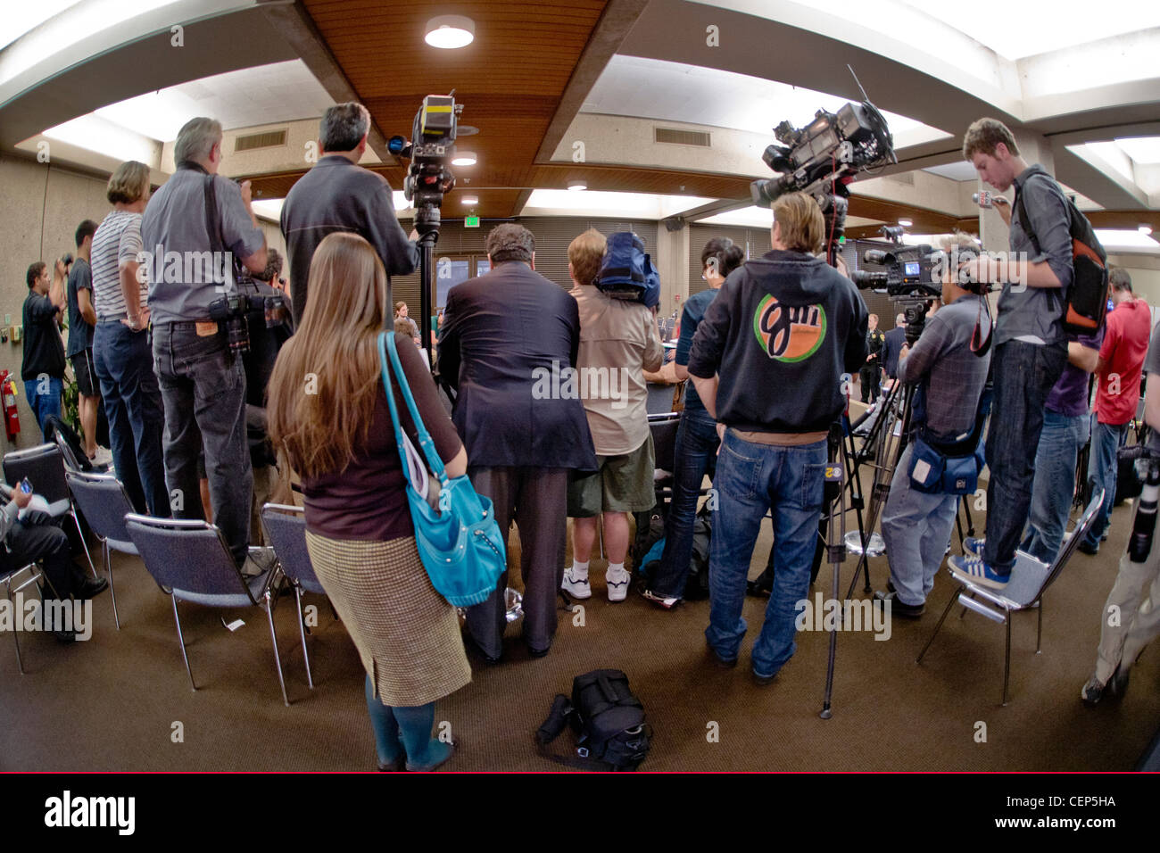 Photographers and television crews cover a student protest over tuition increases at the University of California - Stock Image