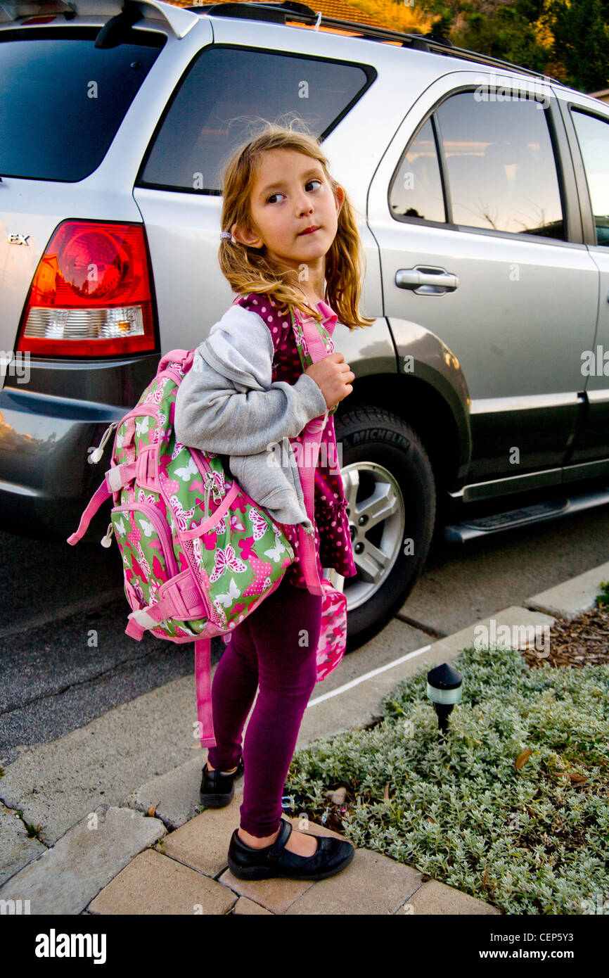 Carrying her backpack and lunch box 6cd5ba003fdc