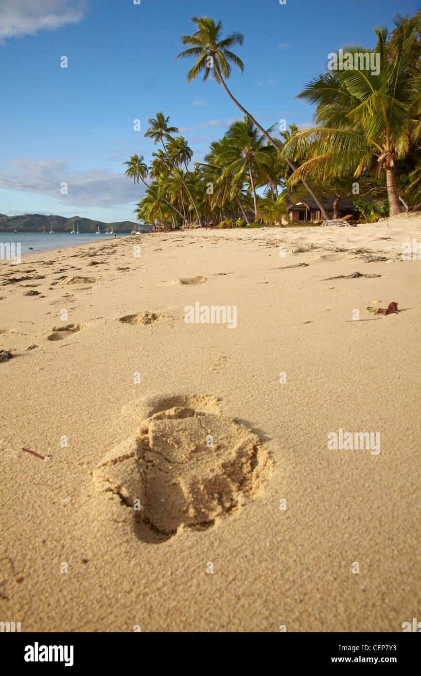 Footprint on beach, Plantation Island Resort, Malolo Lailai Island, Mamanuca Islands, Fiji, South Pacific - Stock Image