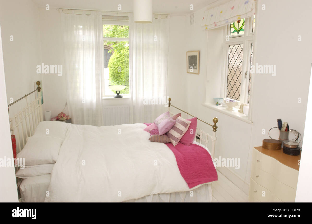 Renovated Flat Interiimage of bedroom iron bed pink cushions ...
