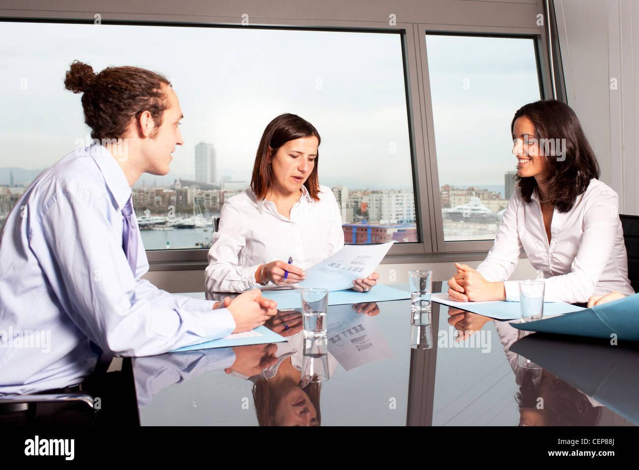 businesspeople interacting at business meeting - Stock Image