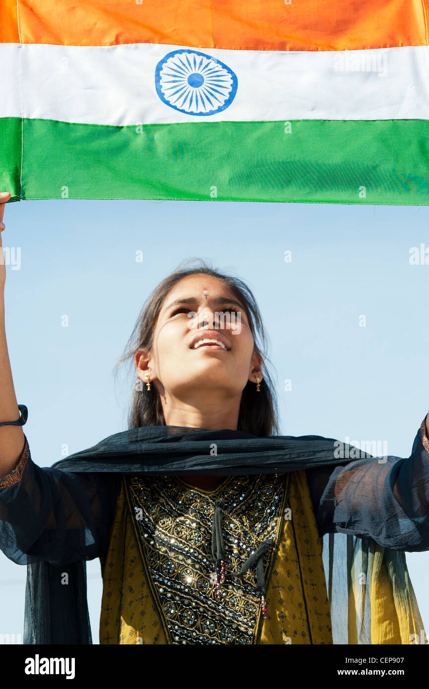 Happy Indian teenage girl holding an Indian flag - Stock Image