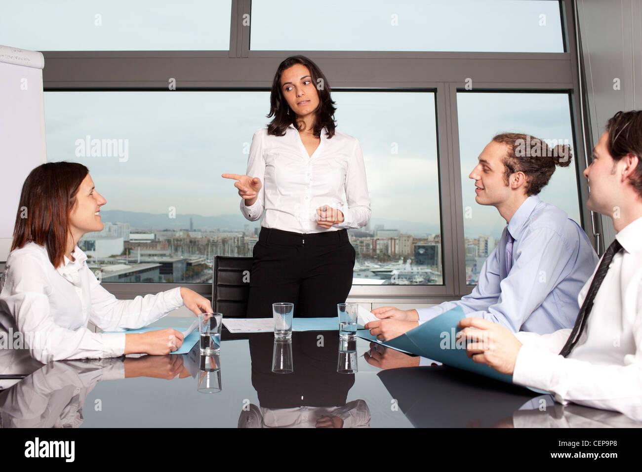 female boss warning a worker making a joke - Stock Image