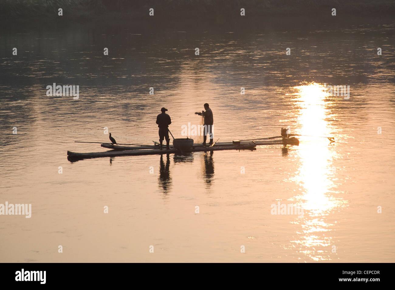 Men On A Raft Fishing - Stock Image