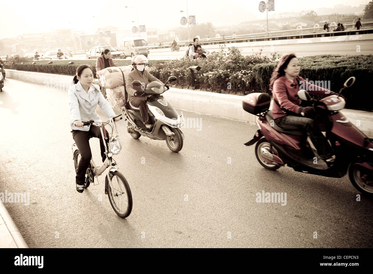 People Riding Bicycles And Motorcycles - Stock Image