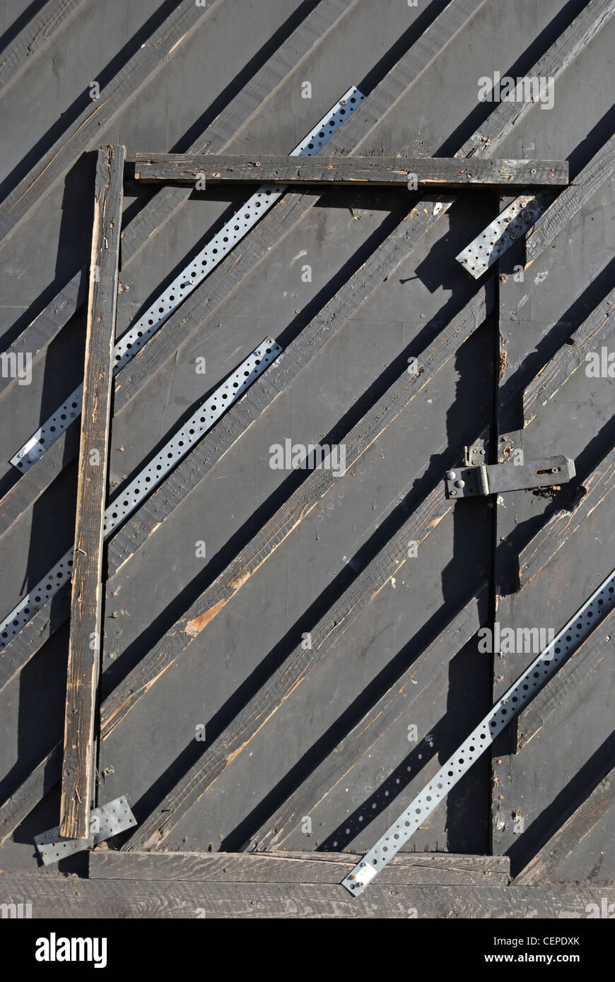 concealed temporary entrance giving workers access to a construction site in kings cross, london, england - Stock Image