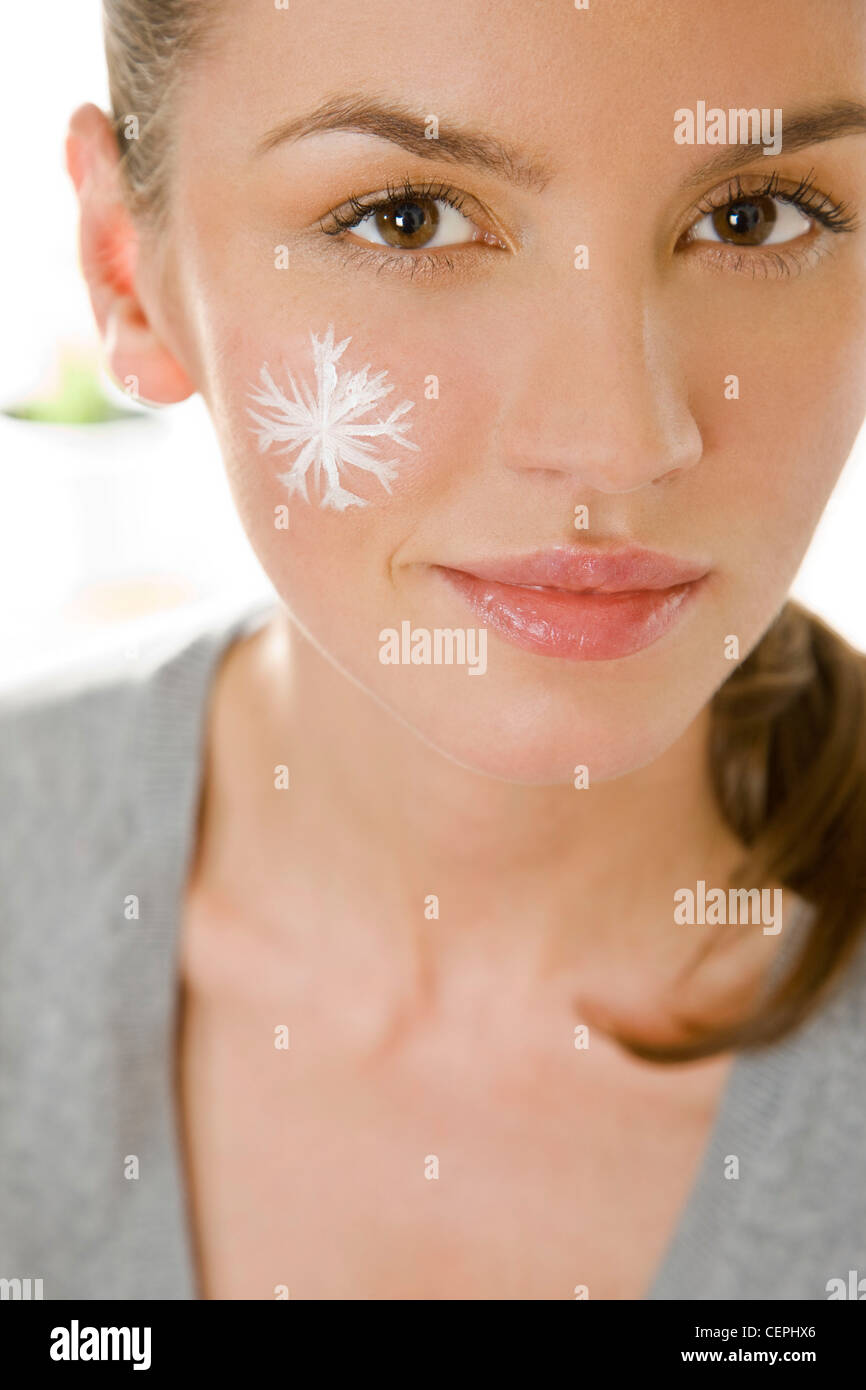 Woman with winter facial cream - Stock Image