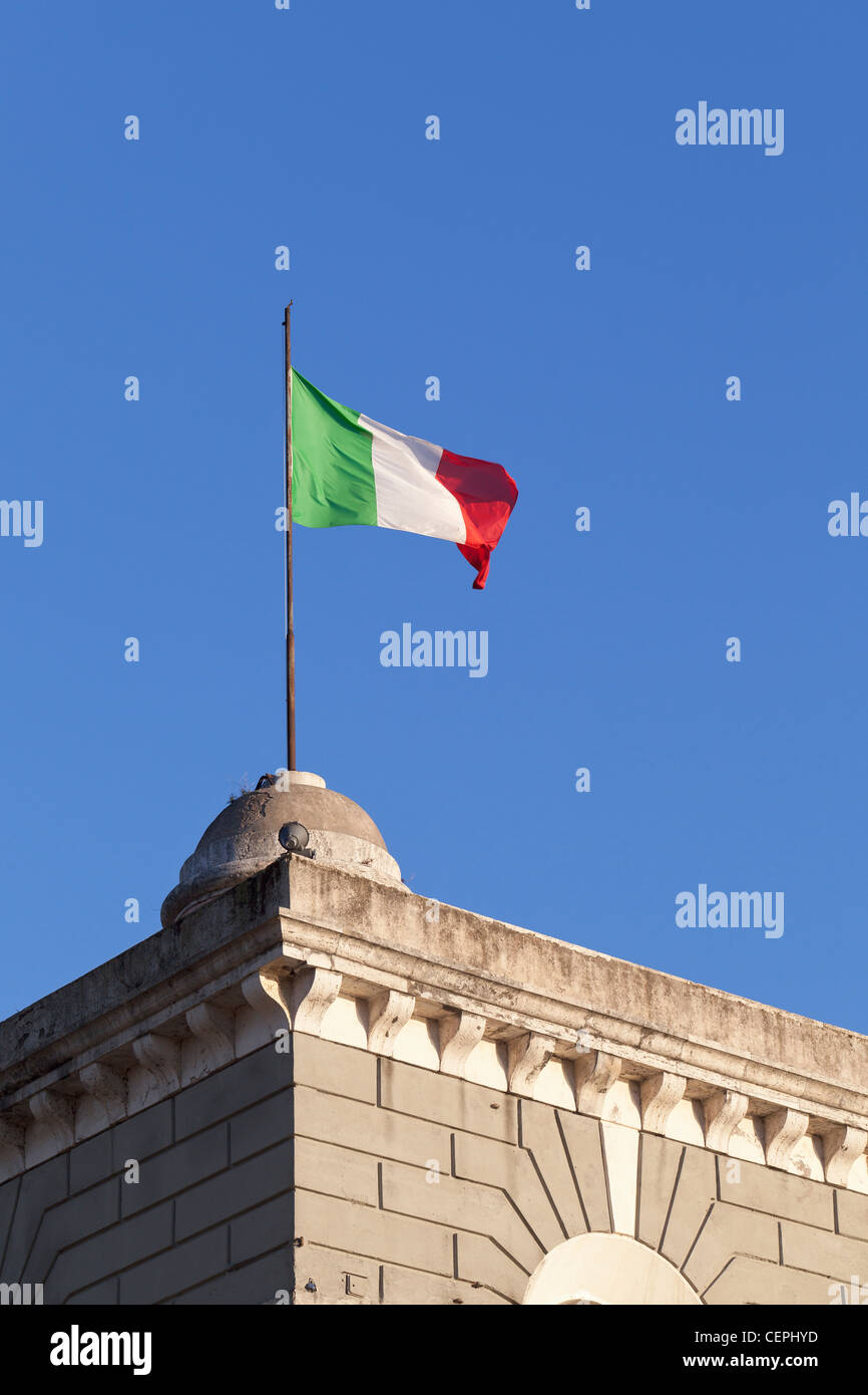 Italian flag fluttering on a building in Rome, Italy - Stock Image