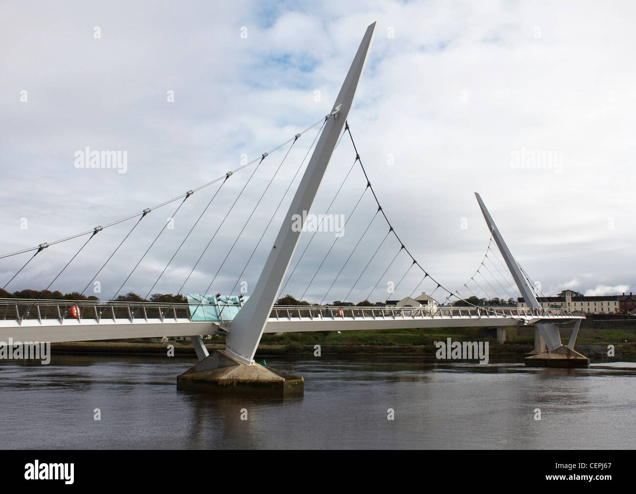 The 'Peace Bridge' across the River Foyle, linking the two communities in the City of Derry, Northern Ireland. - Stock Image