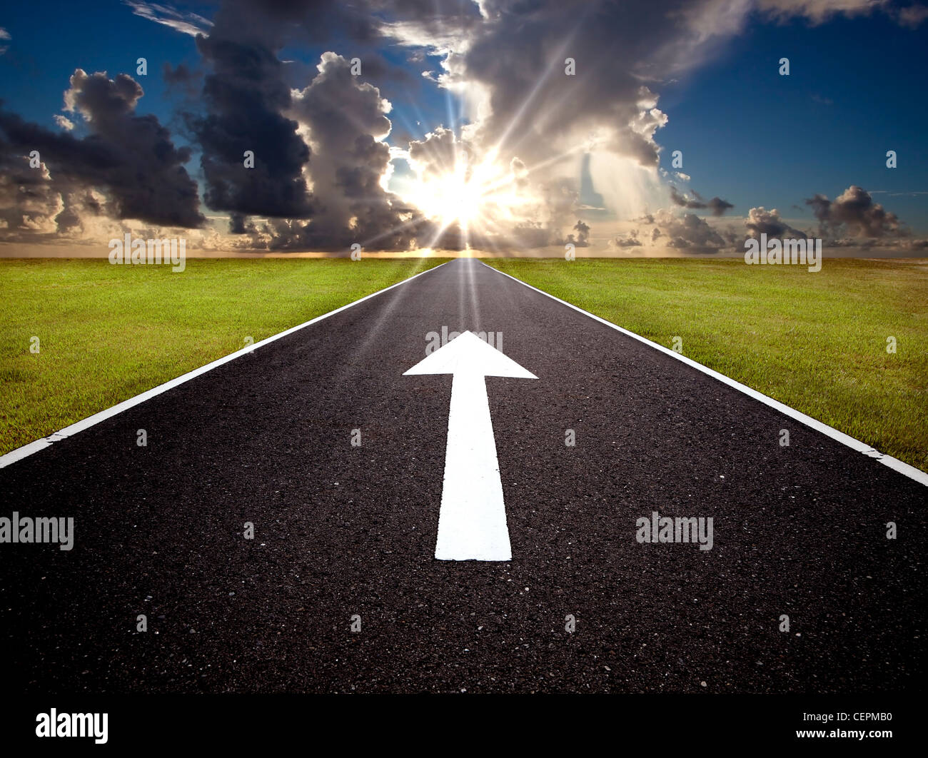 The road to the sunrise and hope. - Stock Image