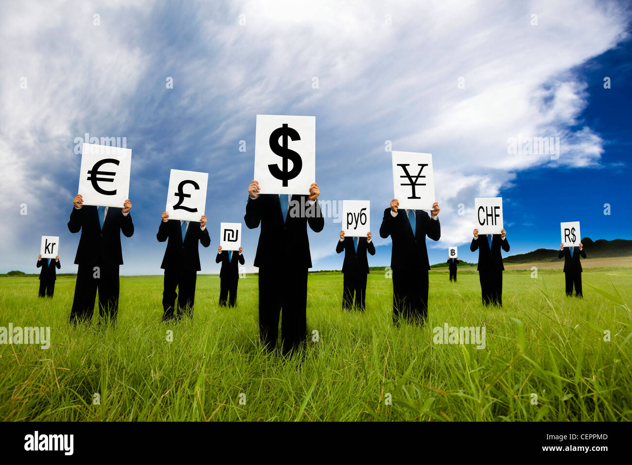 group of businessman holding different money symbol and stand in the field - Stock Image
