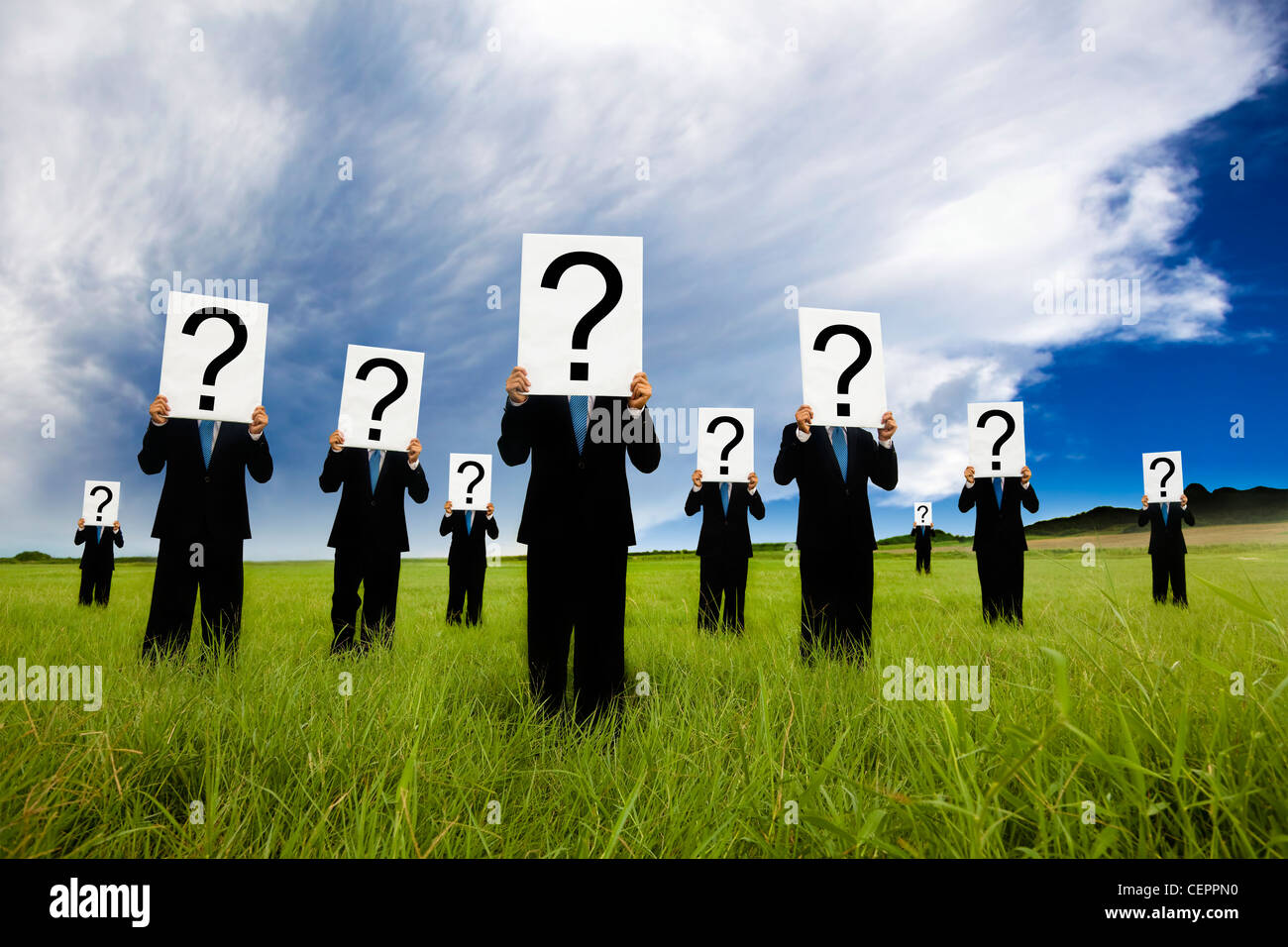 group of businessman in black suit and holding question mark symbol - Stock Image