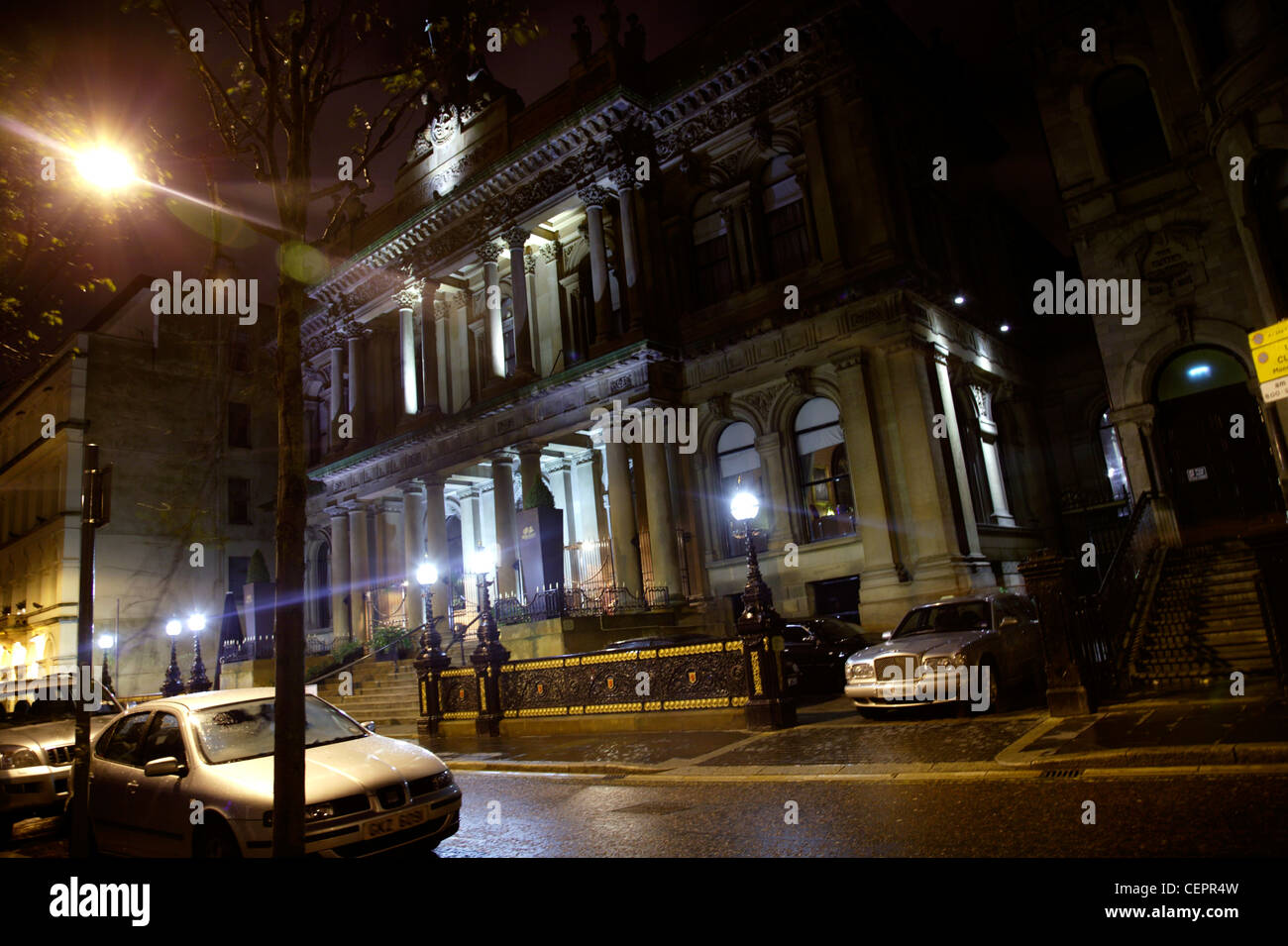 Exterior night view of the grade 1 listed Merchant Hotel in Belfast. Stock Photo