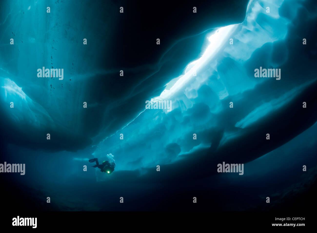 Ice Diving in Mountain Lake Sassolo, Sambuco Valley, Ticino, Switzerland - Stock Image