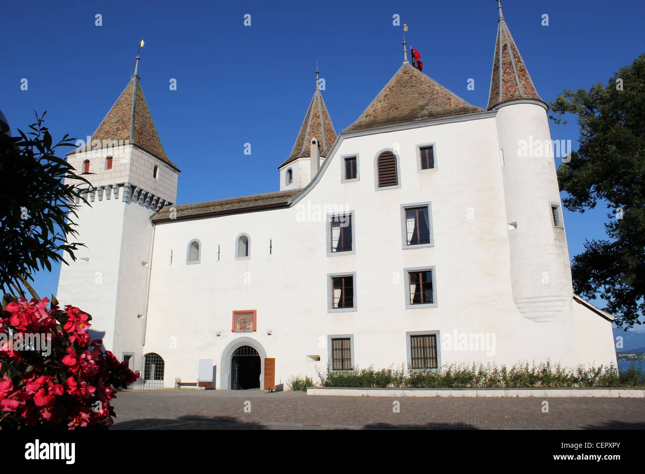 Facade and entrance of the white old castle in Nyon, Switzerland. - Stock Image