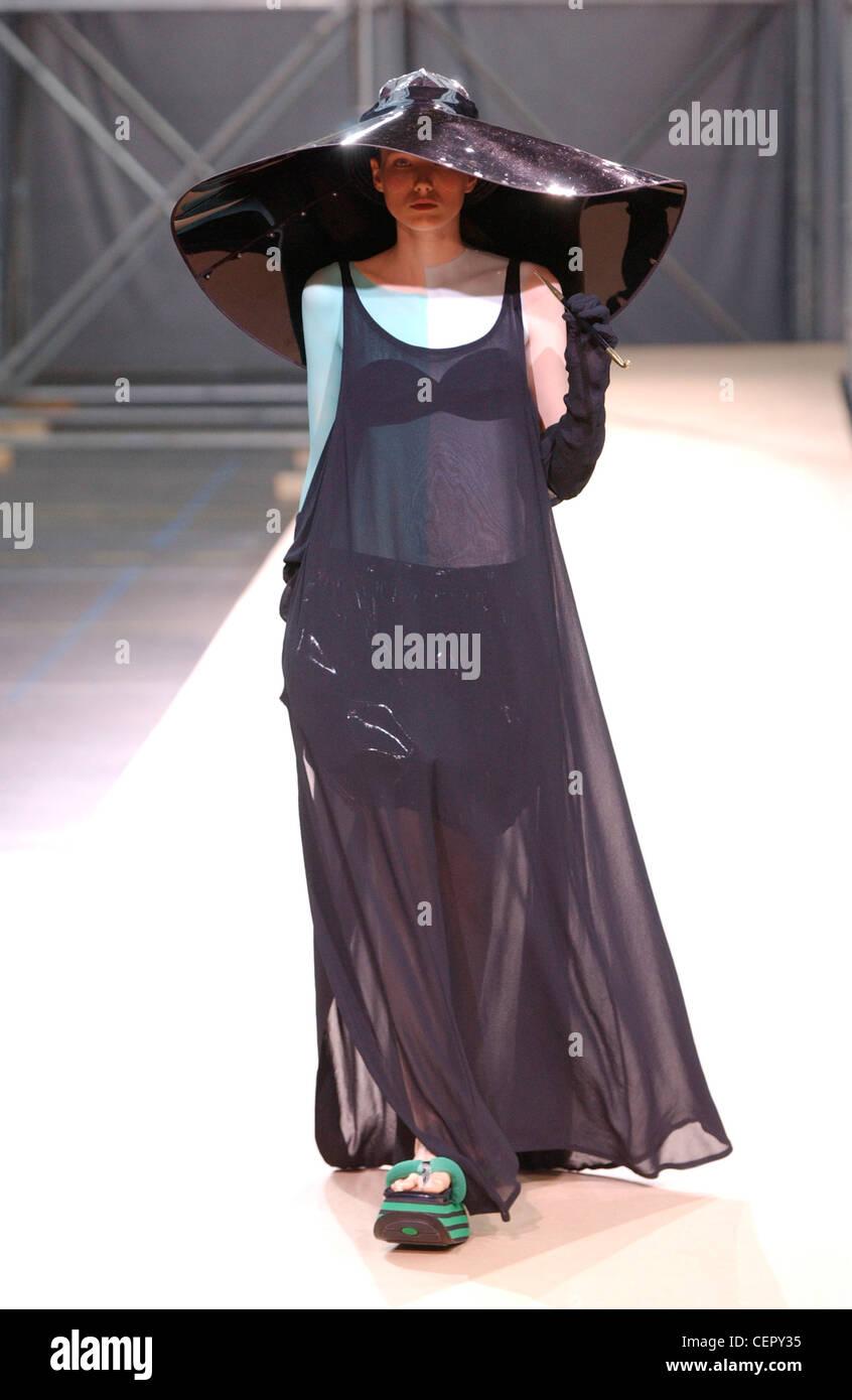 4cfc9a27a17 Yohji Yamamoto Haute Couture Paris autumn winter fashion show Model wearing  large black hat