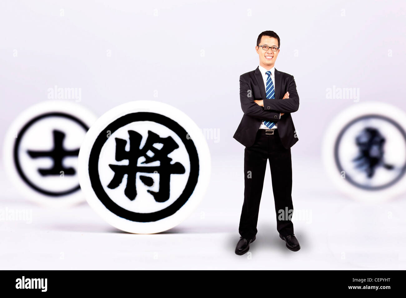 businessman with chinese chess. business Strategy concept - Stock Image