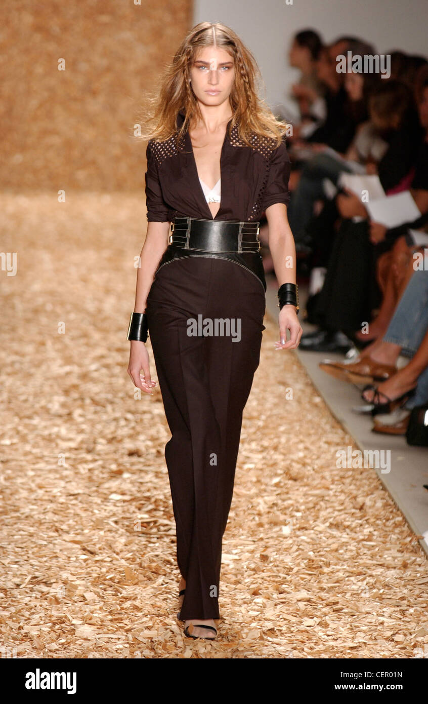 Anne Klein Ready to Wear New York spring summer fashion show Model long fair hair plaits wearing black catsuit sparkly Stock Photo