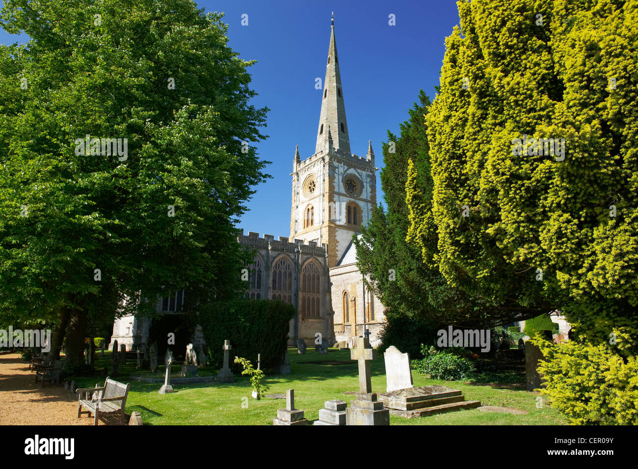 The Collegiate Church of the Holy and Undivided Trinity and cemetery. William Shakespeare was baptised in the church - Stock Image