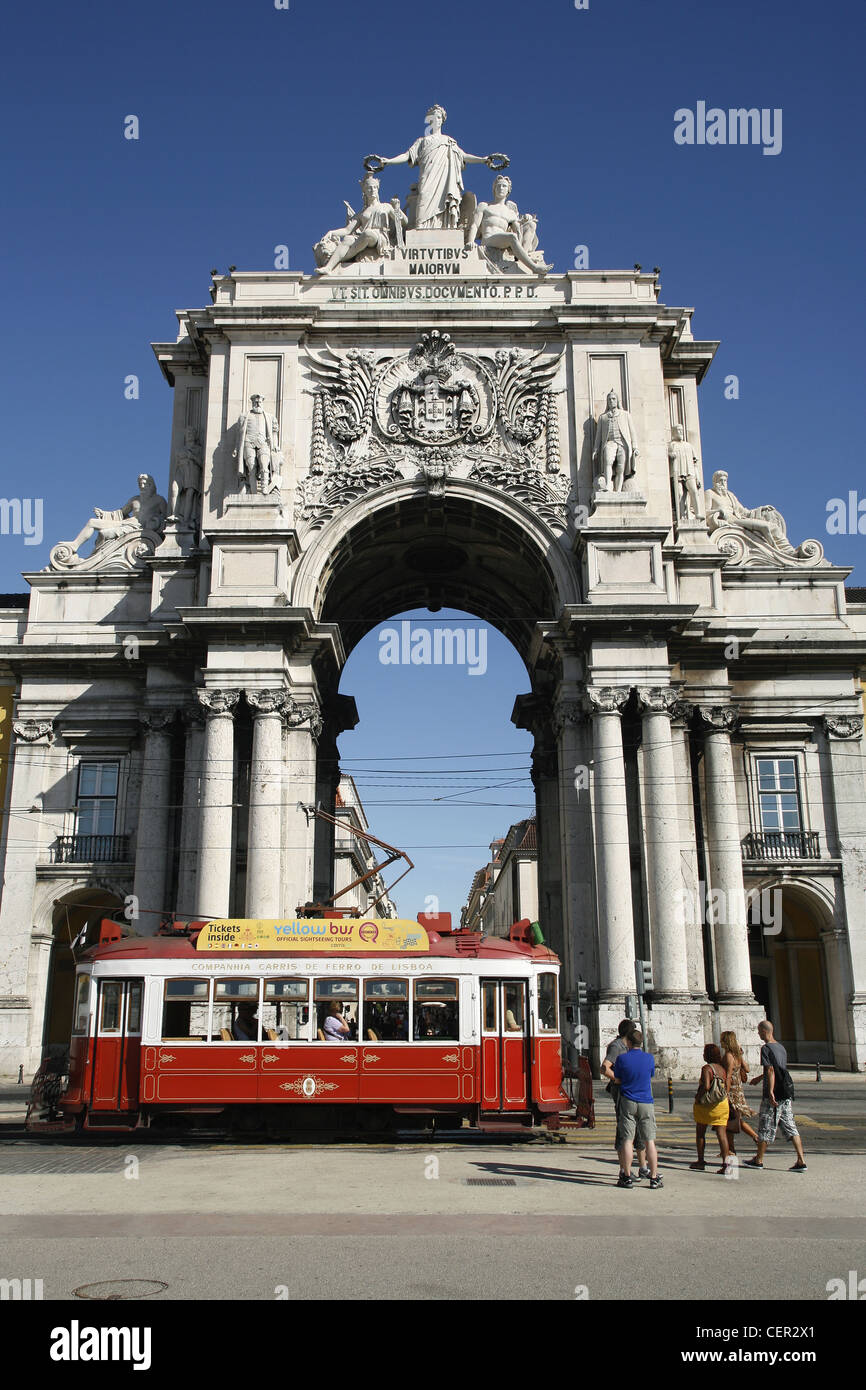 Rua Augusta Arch and a Yellow Bus Sightseeing Tour Tram, Praça do Comércio, Lisbon, Portugal - Stock Image