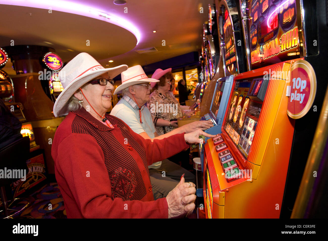 People playing fruit and slot machines in a Mecca Bingo club in Wednesbury, Sandwell, West Midlands. - Stock Image
