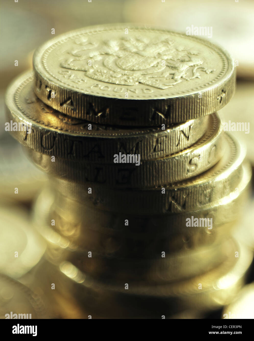 Detail of one pound coins stacked up. - Stock Image