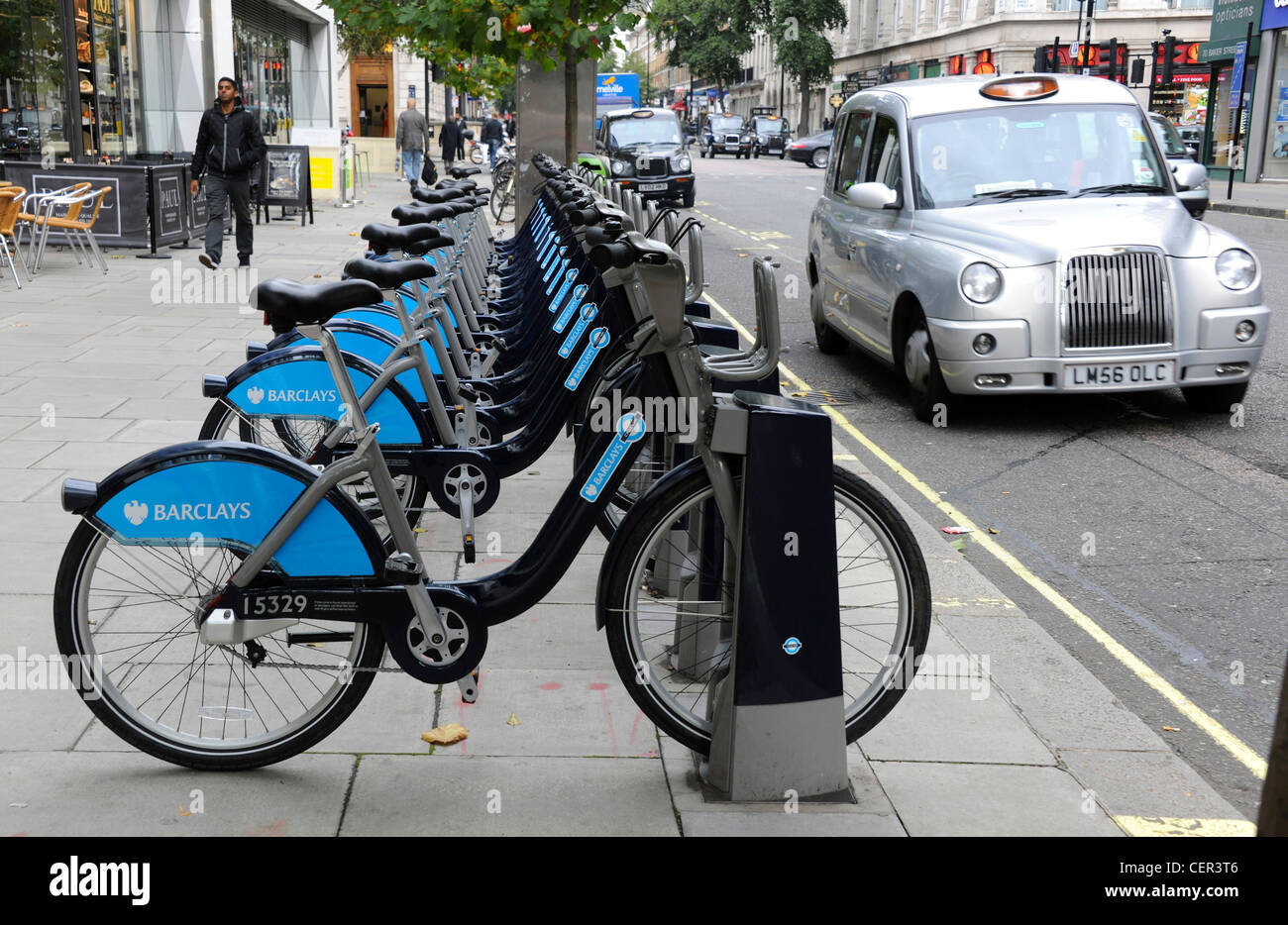 A Barclays Cycle Hire docking Station on Baker Street. Stock Photo