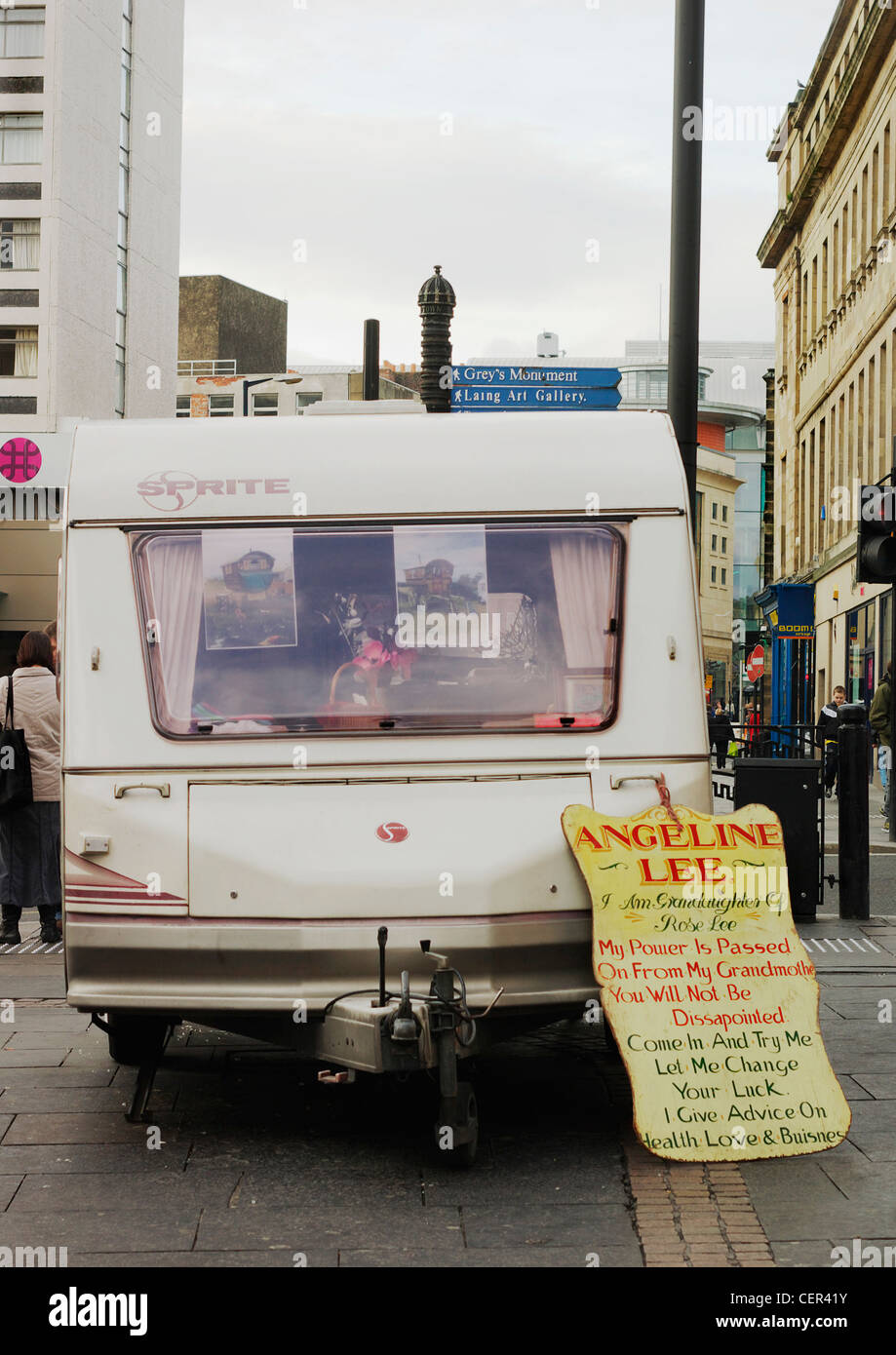 A fortune tellers caravan with a sign leaning against it in the city. - Stock Image