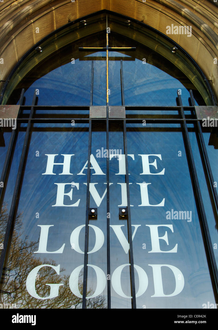 The words Hate Evil Love Good on the entrance to St. Thomas the Martyr church. Stock Photo