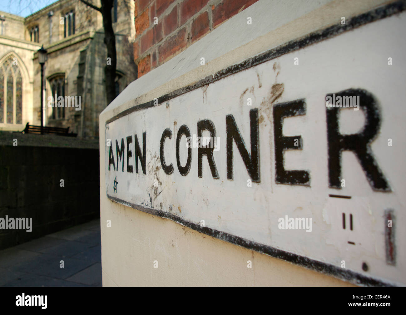 A street sign reading Amen Corner next to a cathedral. Stock Photo