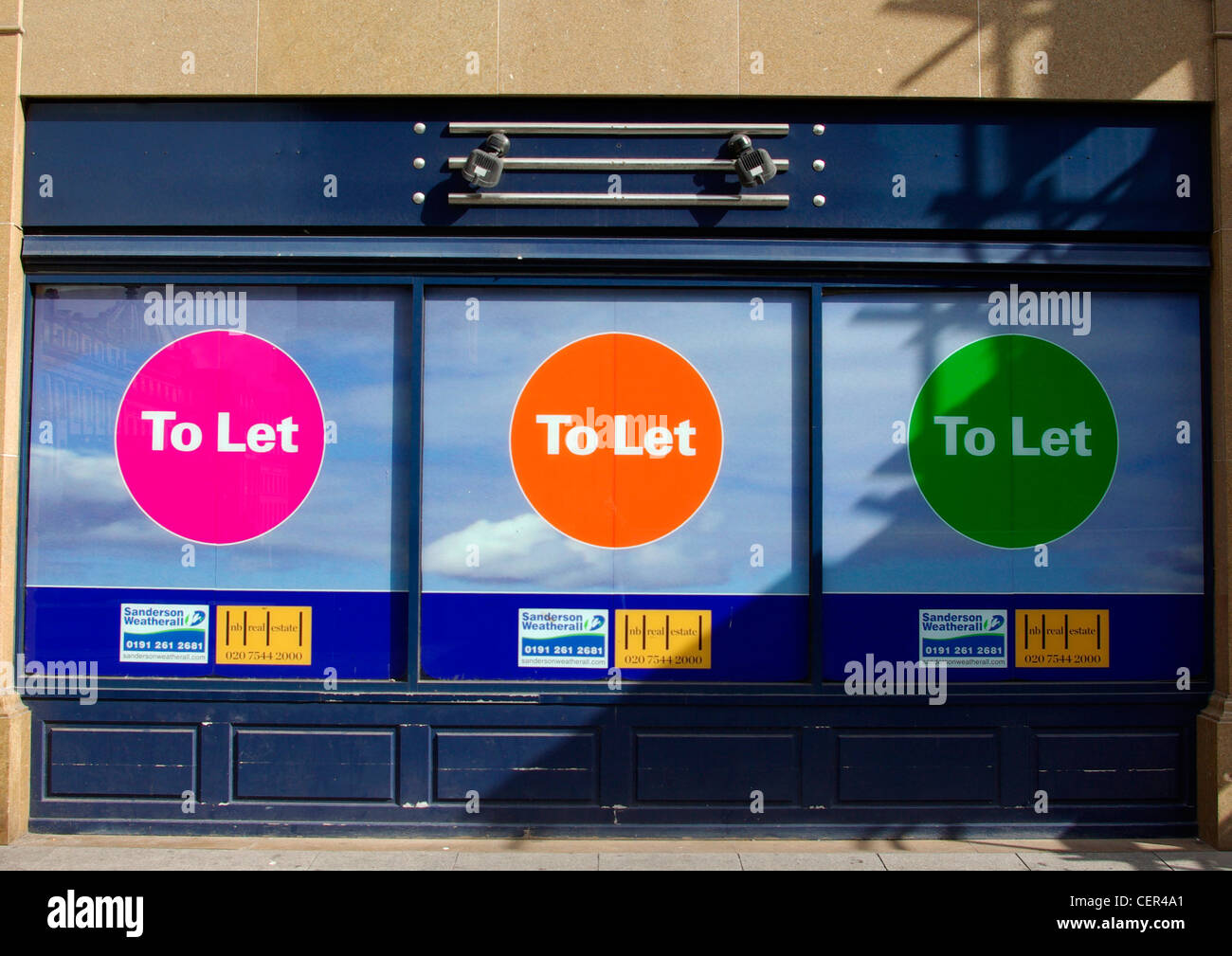 A shop with three To Let signs in the window. Stock Photo