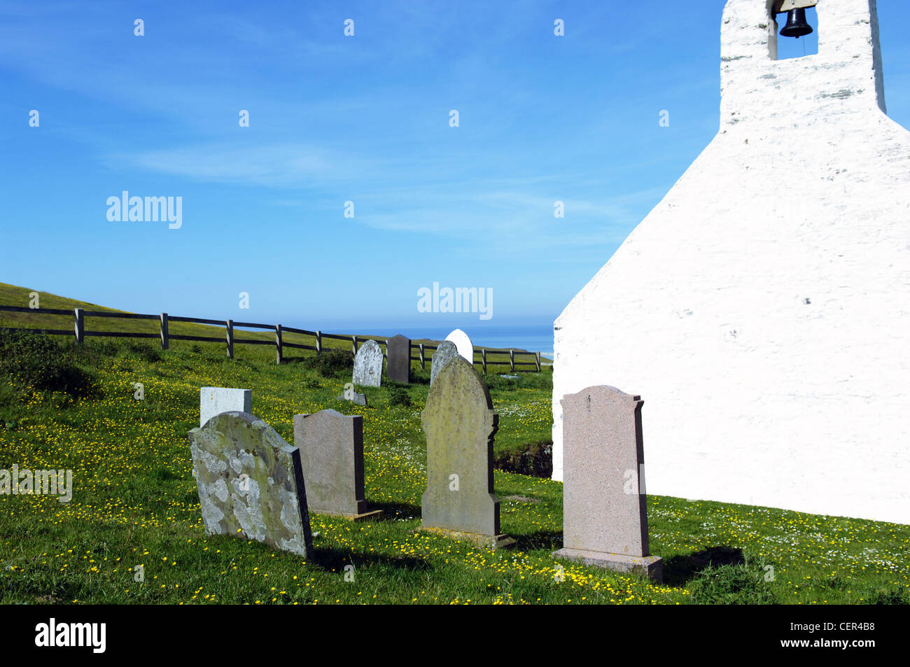 Mwnt Church and headstones. - Stock Image