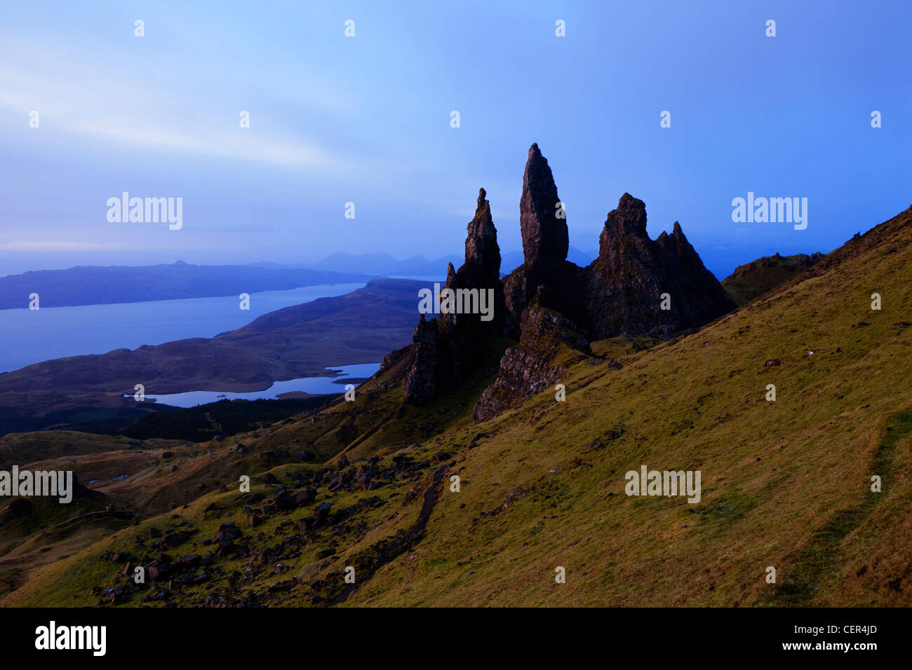 The Old Man of Storr, dramatic pinnacles of rock remaining from ancient landslips on the Trotternish peninsula with - Stock Image