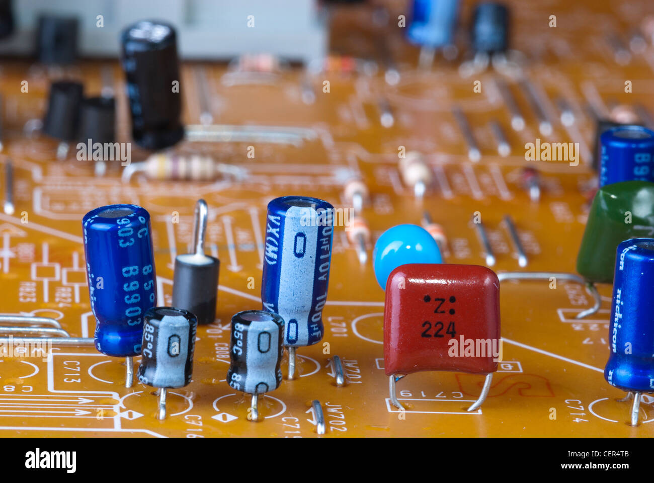 circuit board with chips and capacitors - Stock Image