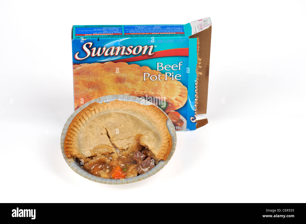 Cooked Swanson beef pot pie tv dinner in front of packaging on white background cut out. - Stock Image