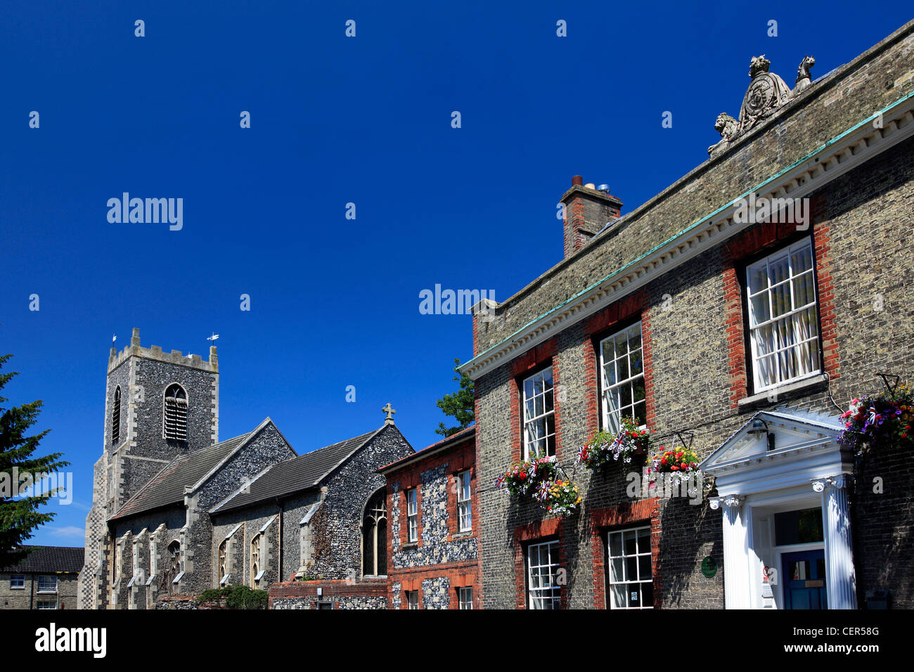 St Peters Parish Church and the Kings House in Thetford Town Norfolk England UK - Stock Image