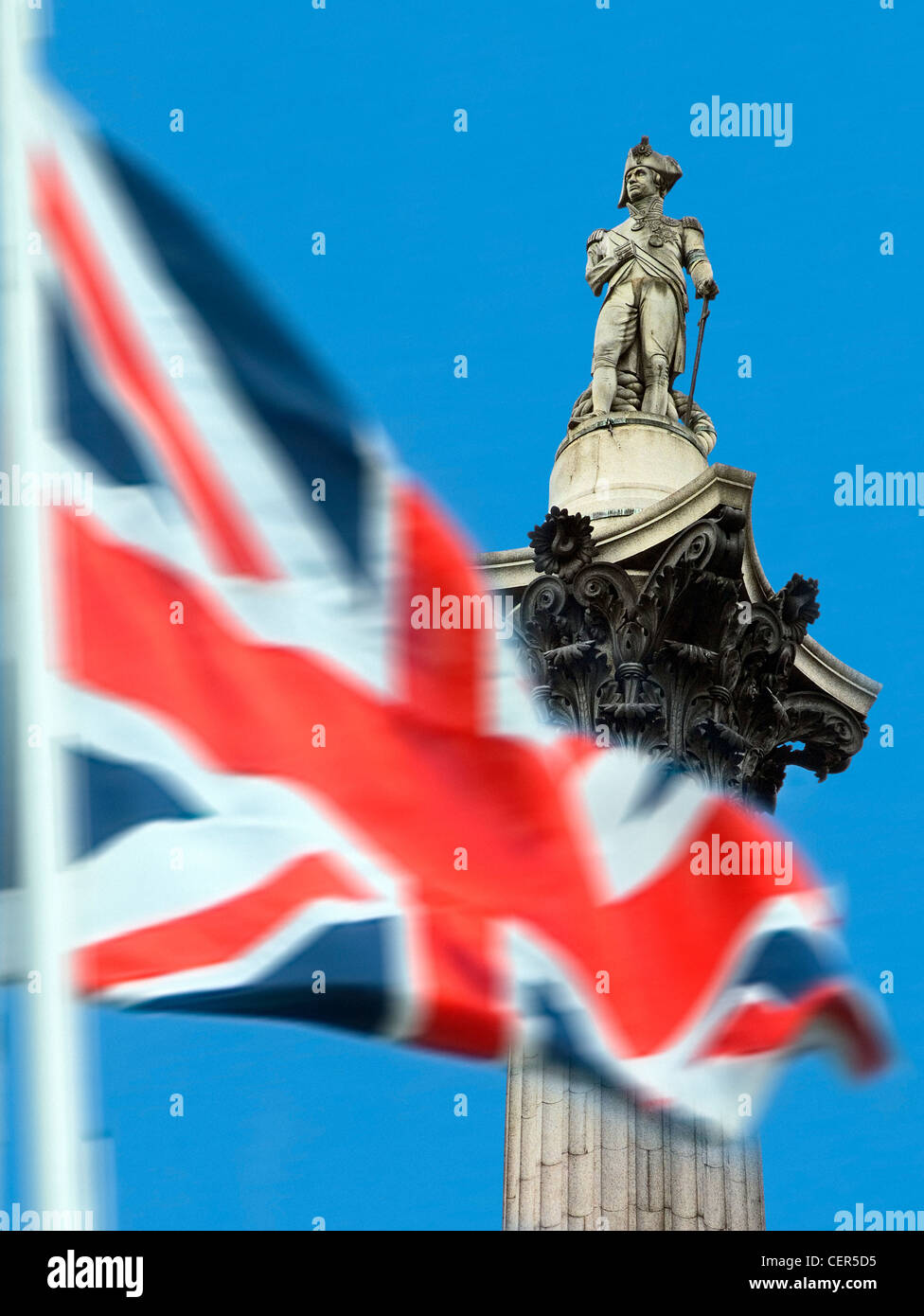 Union Jack with Nelson's Column in background. The column was built between 1840 and 1843 to commemorate Admiral - Stock Image