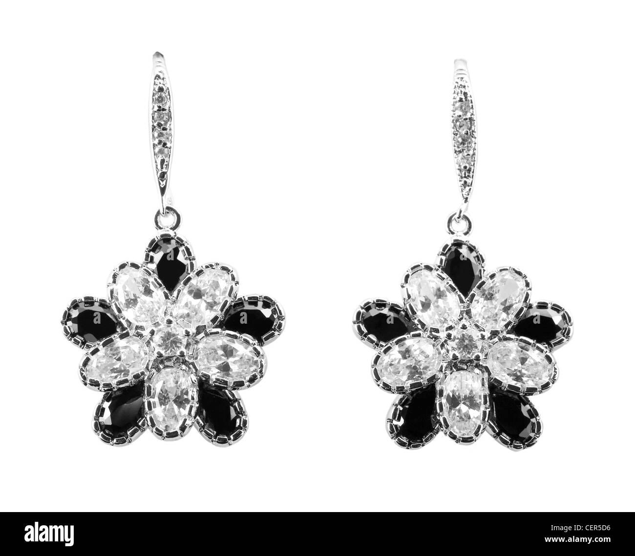 Earrings with diamonds. Isolated - Stock Image