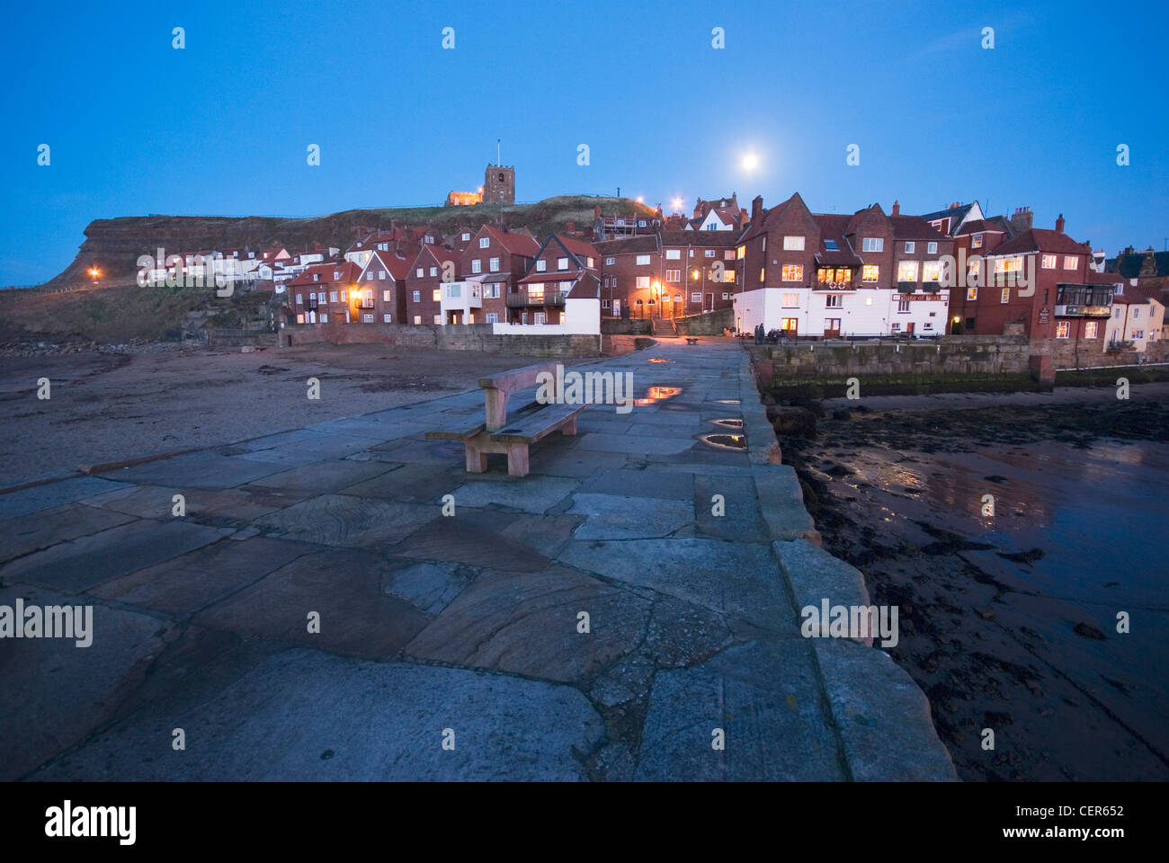 An evening view towards the old town of Whitby from the waterfront. - Stock Image