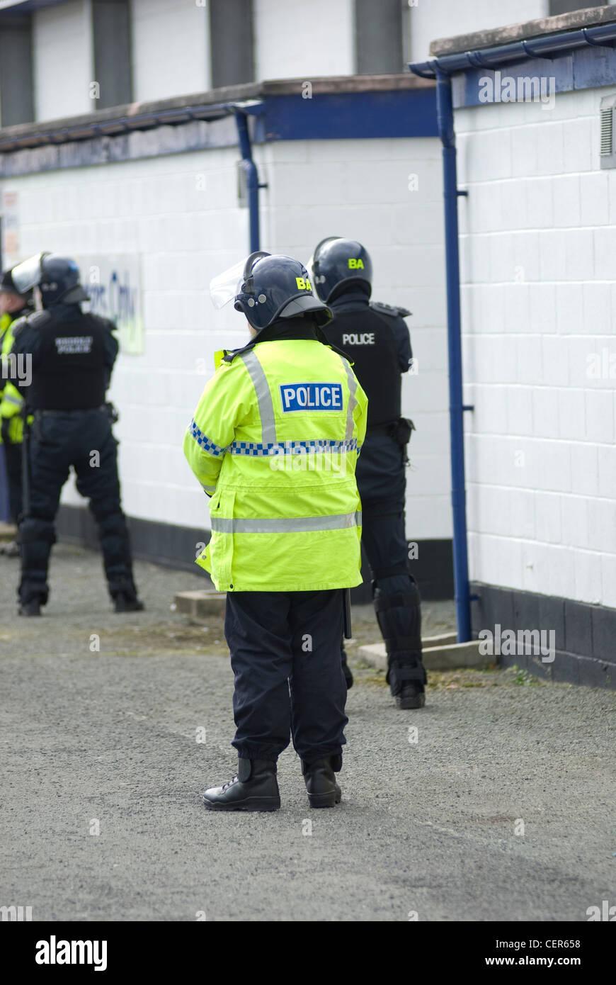 Uk riot police at the scene of a civil disturbance - Stock Image